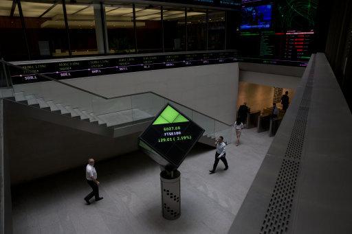 Financial information displayed nside the London Stock Exchange. Picture: AP Photo/Matt Dunham